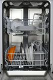 Kitchen dishwasher with dirty dishes inside ready to wash royalty free stock photo