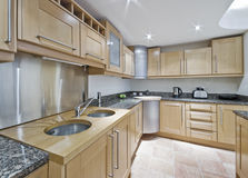 Kitchen with double sink. Modern kitchen with double sink and accessories royalty free stock image