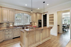 Kitchen with double-tiered island Stock Image