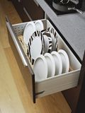 Kitchen drawer with plates Royalty Free Stock Image