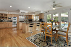 Kitchen with eating area. And view of swimming pool Royalty Free Stock Image