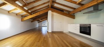 Kitchen in empty apartment with wooden beams. Nobody inside stock images