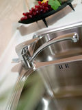 Kitchen faucet. The kitchen faucet stainless steel Royalty Free Stock Photo