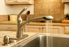 Kitchen faucet Stock Images