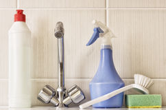 Kitchen faucet, brush and detergent. Royalty Free Stock Photo