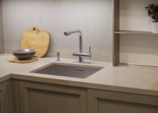 Kitchen faucet, modern gray kitchen in loft style, gray table, luxury faucet kitchen stock photos