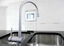 Kitchen faucet and oven modern black and white Royalty Free Stock Images
