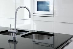 Kitchen faucet and oven modern black and white Stock Photo