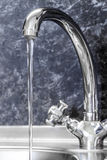 Kitchen faucet and sink close up Royalty Free Stock Images
