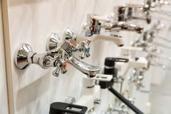 Kitchen faucets on shelf closeup, plumbing shop Royalty Free Stock Images