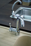 Kitchen faucets with stainless steel sink. Two kitchen faucets with stainless steel sink royalty free stock photo