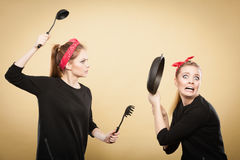 Kitchen fight between retro girls. Royalty Free Stock Photo