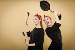 Kitchen fight between retro girls. Stock Image