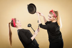 Kitchen fight between retro girls. Royalty Free Stock Image
