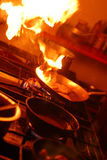Kitchen flambe. With huge flames in the dark Royalty Free Stock Image