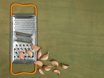 Kitchen Food Grater With Garlic Cloves Royalty Free Stock Images
