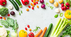 Kitchen - fresh colorful organic vegetables on worktop. Kitchen - fresh colorful organic vegetables captured from above top view, flat lay. Grey stone worktop as Stock Photo