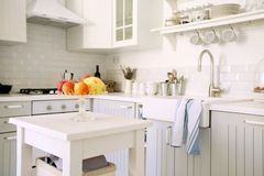 Kitchen with fruits. Modern white kitchen with antique look