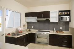 Kitchen. Full kitchen with storage space, stove and microwave stock photos
