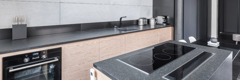 Kitchen with functional worktop stock photography