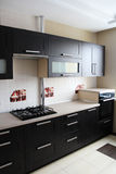 Kitchen furniture. Brown kitchen cabinets. Stock Photography