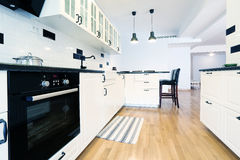 Kitchen furniture. White modern kitchen furniture, seen from above Royalty Free Stock Images