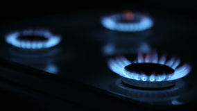 Kitchen Gas Burners. Tree kitchen gas burners on and off successively stock footage