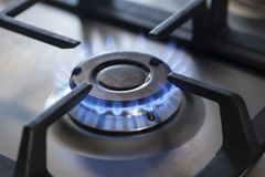 Kitchen gas cooker with burning fire propane gas. The kitchen gas cooker with burning fire propane gas royalty free stock images