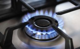 Kitchen gas cooker with burning fire propane gas.  stock photo