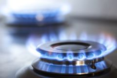 Kitchen gas cooker with burning fire propane gas.  royalty free stock photos