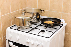 Kitchen gas oven metal pot Royalty Free Stock Photography