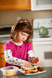 Kitchen Girl: Young Girl Making Own Lunch Stock Images