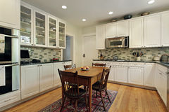 Kitchen with glass cabinets Stock Photos