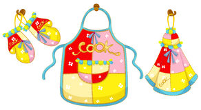 Kitchen glove and apron and hand towel Royalty Free Stock Image