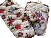 Kitchen gloves. For the oven with floral design. Isolated Royalty Free Stock Image