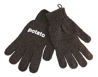 Kitchen gloves for peeling young potato Royalty Free Stock Photography