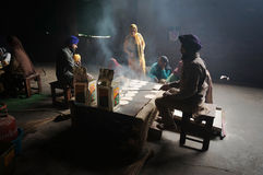 In the kitchen of the Golden temple, women cook, chapati - traditional Indian bread. Royalty Free Stock Photography