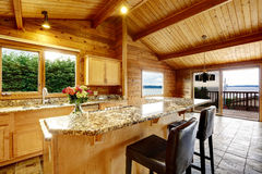 Kitchen with granite counter top. Wooden trim home with open floor plan. Kitchen with granite counter top. Water view royalty free stock image