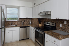 Kitchen with granite counter tops Stock Photography