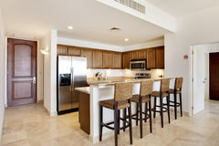 Kitchen with Granite Countertop. Entry view of kitchen and condominium Royalty Free Stock Images