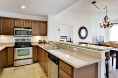 Kitchen with Granite Countertop. Kitchen view with range, microwave, and dishwasher Stock Photo