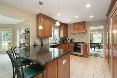 Kitchen with granite island Stock Photos