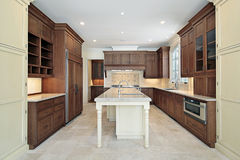 Kitchen with granite island. Kitchen in new construction home with granite island royalty free stock photography