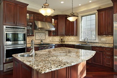 Kitchen with granite island Stock Photography