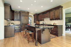 Kitchen with granite island top royalty free stock images