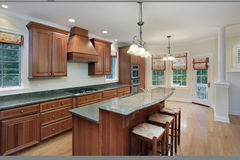 Kitchen with granite island top. Kitchen in luxury home with granite top center island stock photos