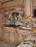 Kitchen granite range and hood design. Kitchen with range and hood with wood cabinets and granite stone royalty free stock photos