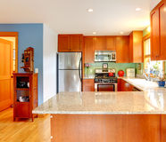 Kitchen with granite tops and green back splash Royalty Free Stock Photography
