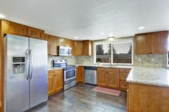 KItchen with granite tops and tile back splash trim Stock Images