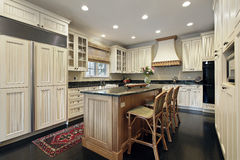 Kitchen with granite and wood island Royalty Free Stock Photo
